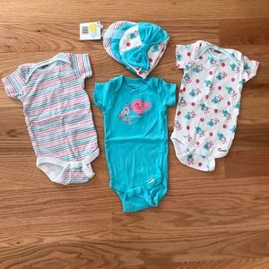 Set of three onesies with matching beanies